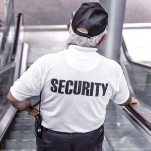Flex Point Security guard providing loss prevention/retail security services at a mall
