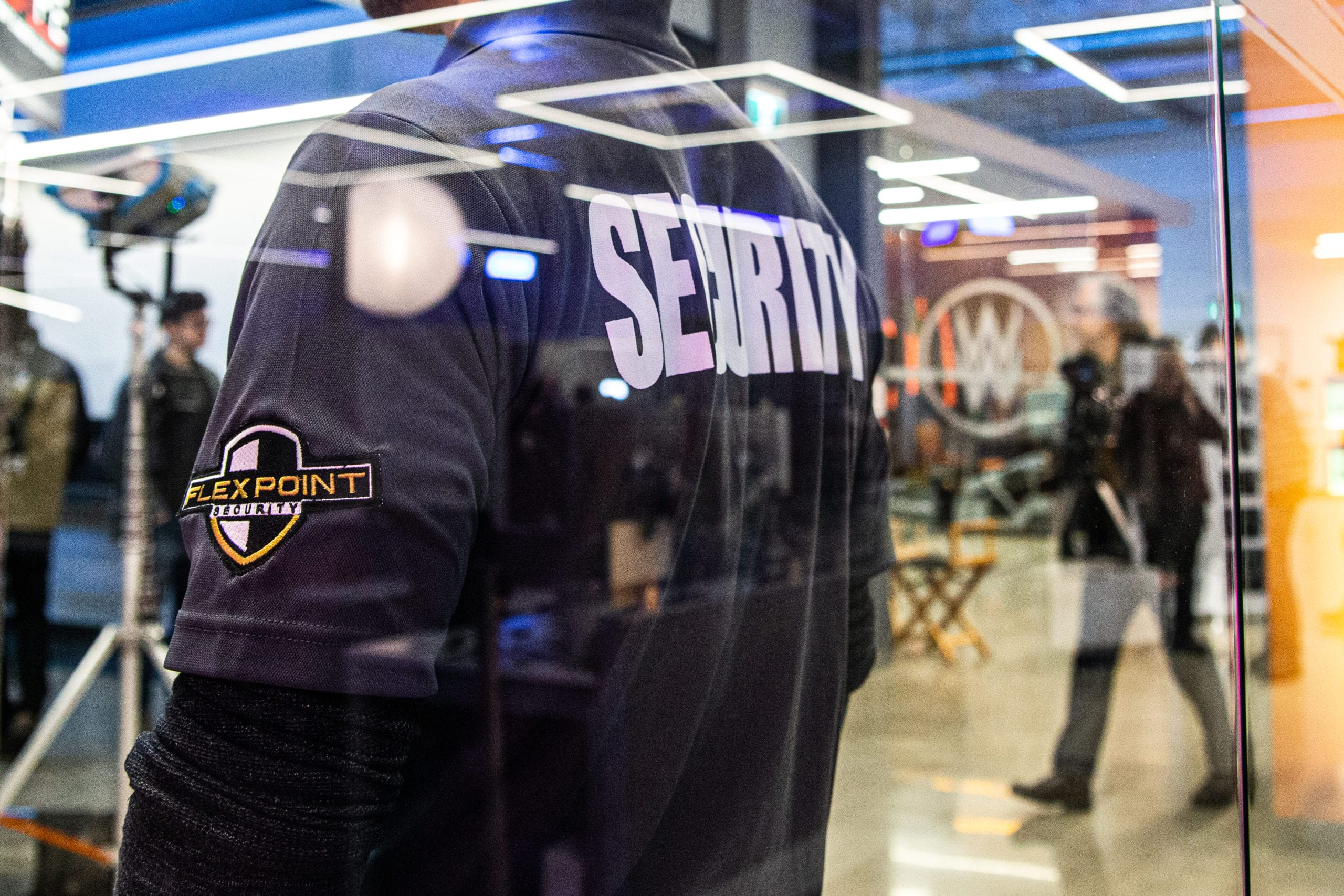 Flex Point Security guard providing event security services on set of a video shoot
