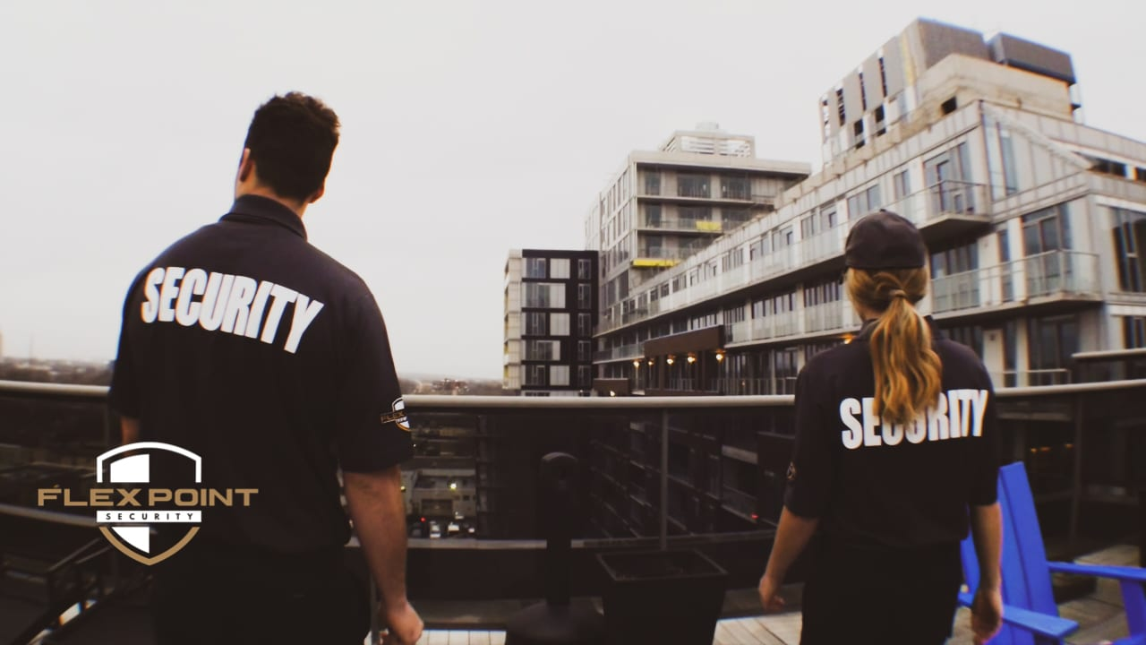 Two Flex Point Security guards standing on a condominium terrace while providing residential security services