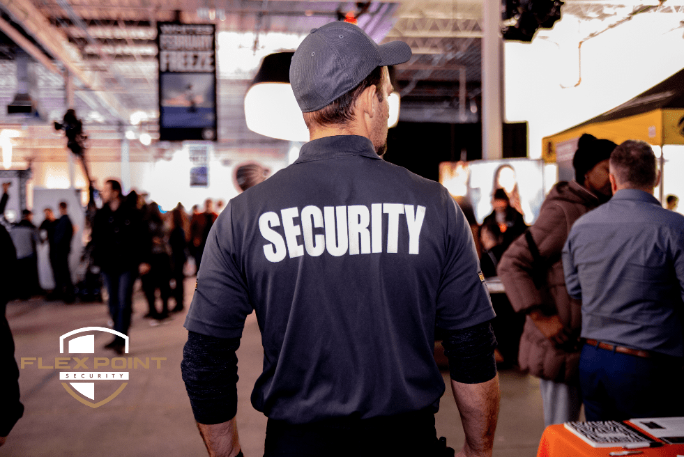 Flex Point Security guard providing event security services at a public convention