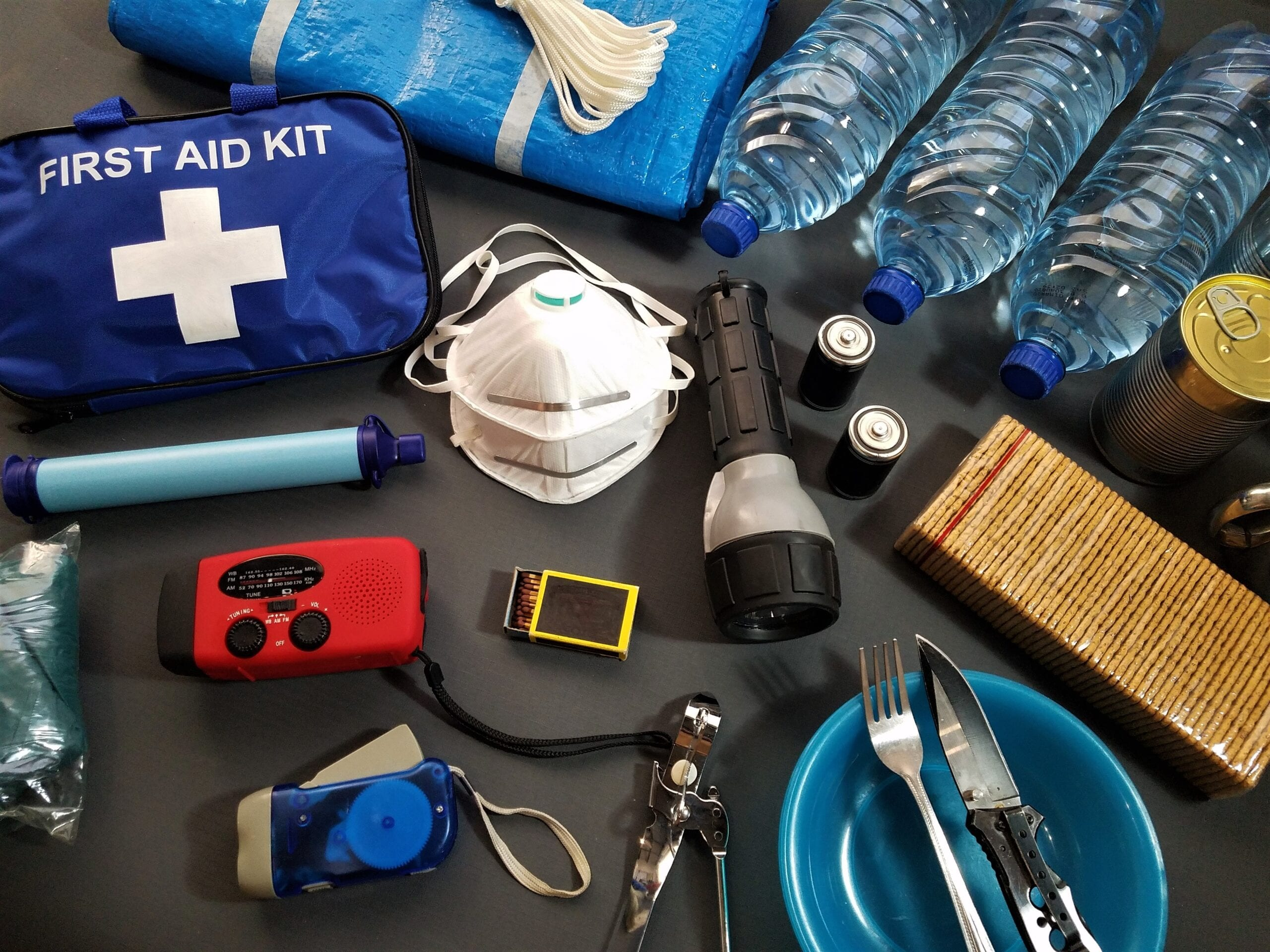 First aid kit and equipment spread out on a table